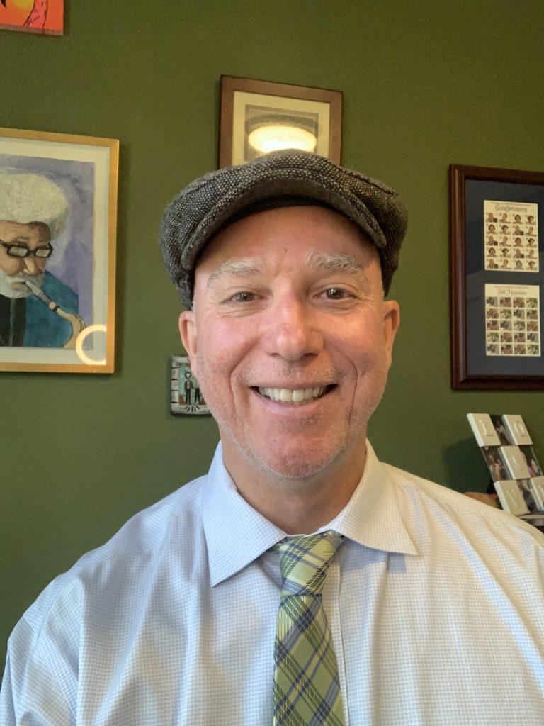 Dan Hanley wearing a cap